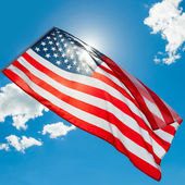USA flag waving on blue sky background - 1 to 1 ratio — Stock Photo