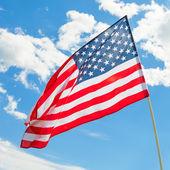 USA flag waving on blue sky background - outdoors shoot - 1 to 1 ratio — Stock Photo