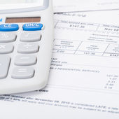 Utility bill and calculator - 1 to 1 ratio — Stock Photo