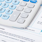 Receipt next to calculator - studio shot - 1 to 1 ratio — Stock Photo