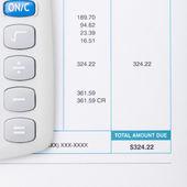 Calculator next to a bill - studio shot - 1 to 1 ratio — Stock Photo