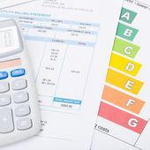 Calculator with utility bill and energy rating chart - 1 to 1 ratio — Stock Photo