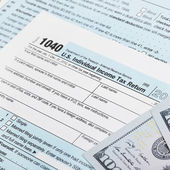 USA Tax Form 1040 with 100 US dollar bills — Stock Photo