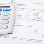 Utility bill and calculator over it - 1 to 1 ratio — Stock Photo