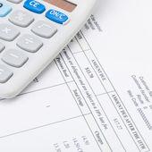 Studio shot of utility bill next to calculator - 1 to 1 ratio — Stock Photo