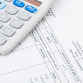 Studio shot of utility bill next to calculator - 1 to 1 ratio — Stock Photo