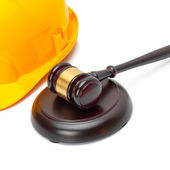 Wooden judge gavel and yellow color protective helmet - studio shoot - 1 to 1 ratio — Stock Photo