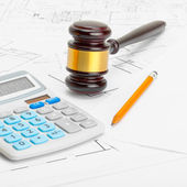 Wooden judge gavel with calculator and pencil over some documents - 1 to 1 ratio — Stock Photo