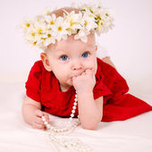 Baby in red dress — Stock Photo