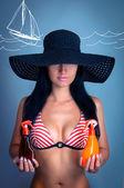 A girl holds a suntan oil — Stock Photo