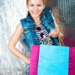 Stock Photo: Shopping.young womwith bright packages