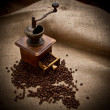 Old Coffee Mill with beans and burlap — Stockfoto