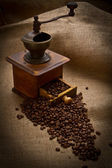 Old Coffee Mill with beans and burlap — Stock Photo