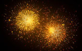 Fireworks over black background — Stock Photo