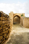 Old City Alley with stone wall — Stock Photo