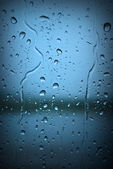 Raindrops on Blue Window — Stock Photo