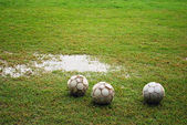 Footballs on a Wet Field — Stock Photo