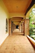 Rustic courtyard hallway — Stock Photo