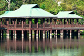 Brown and Green Gazebos on Stilts Above Water — Stock Photo