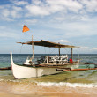 Stock Photo: Wooden Outrigger Boat on Beach Shore