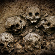 Stock Photo: Stone Skulls Carving Relief