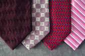 Four ties in tones of red, burgundy and pink — Stock Photo