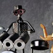 Постер, плакат: Drummer figurine made from various metals and a wooden art figurine