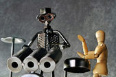 Two drummer figurines playing percussion — Stock Photo
