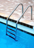 Ladder of a swimming pool, vertical view — Stock Photo