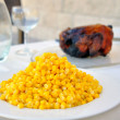 Dinner table with a chicken and corn — Stock Photo #49166781