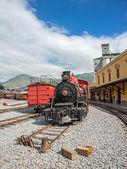 Old locomotive train on a railroad track — Stock Photo