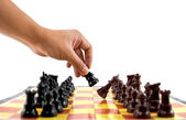 Chess, hand on checkmate — Stock Photo