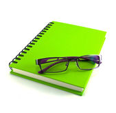 Eyeglasses and notebook — Stock Photo