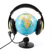 Globe and headphone — Stock Photo