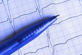 Ballpoint pen on the ECG surface — Stock Photo