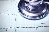 Close up of a stethoscope on an ECG. — Stock Photo