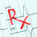 RX (prescription) inscription on cardiogram. — Stock Photo