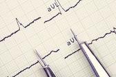 Instrument and cardiogram. medical background — Foto de Stock
