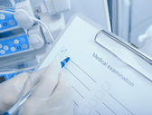 Medical examination. Doctor with a checklist on clipboard in the — Stock Photo