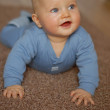 The baby learns to crawl — Stock Photo #20793631