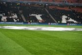 The symbol of the Champions League on the pitch — Stock Photo