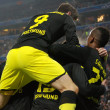 Borussia footballers after a goal scored - Stock Photo