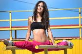 Girl in the splits on parallel bars — Foto Stock