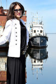 Girl posing near a ship — Stock Photo