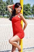 Woman posing  near the volleyball net — Stock Photo