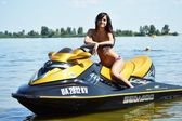 Young woman on a water bike — Stock Photo