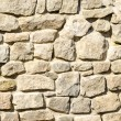 Texture of a wall of crushed stone and masonry — Stock Photo