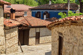 A traditional old street in Koprivshtitsa Bulgaria, from the tim — Stock Photo