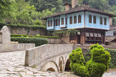 Old house and a stone bridge in the architectural complex Etara, — Stock Photo