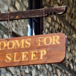 Wooden sign on the wall of the motel — Stock Photo